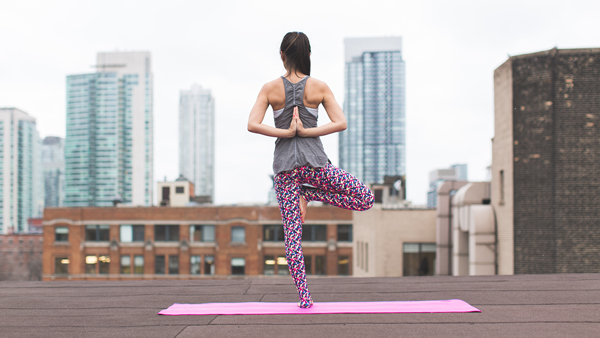 A woman engages in yoga as part of an innovative healthcare initiative provided by GlobalFit.