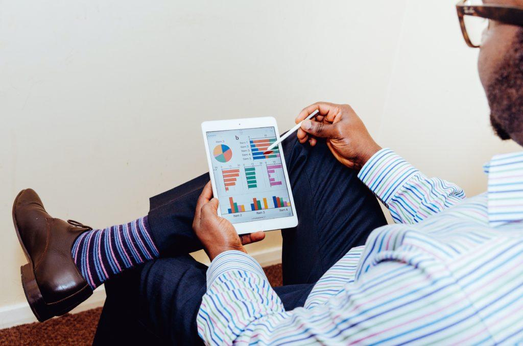 Person examines marketing graphs.