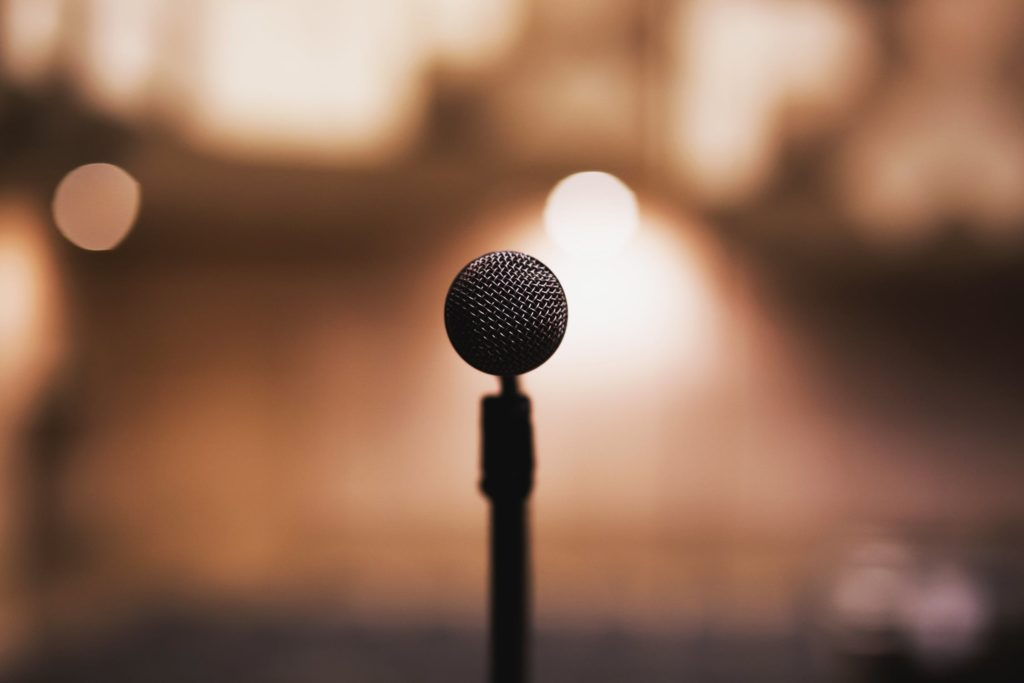 A microphone stands ready for you to tell your story.